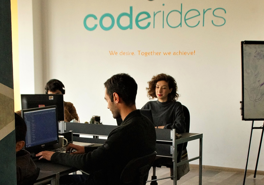 CodeRiders senior-level software developers working on projects